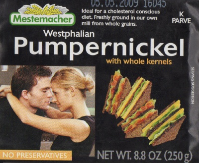 packaging for Mestemacher brand Westphalian Pumpernickel with whole kernels, showing a man and a woman two seconds away from passionate face-sucking