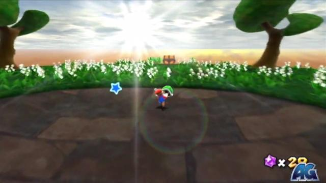 Mario at the top of the slope. The camera has tilted down, revealing a treasure chest in a grassy field with flowers, illuminated by a brilliant sunrise. (This photo comes from a different video, so the player is Mario.)