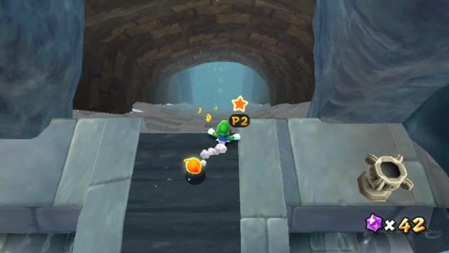 Luigi at the very top of a stone slide, looking down. (The player has switched to Luigi.)